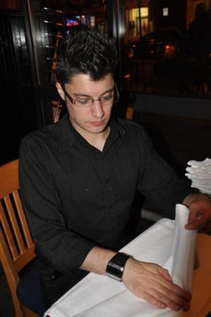 Rob has to fold 40 napkins before leaving (Photo: Reed)